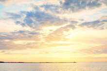 Baltic Sea After The Storm, Panoramic View From A Sailing Boat. Lighthouse, Seagulls. Dramatic Sunset Sky. Glowing Clouds, Golden Sunlight. Idyllic Seascape. Nature, Cruise, Travel Destinations
