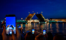 Russia, St. Petersburg, People Who Came To See The Bridges Being Built Shoot What Is Happening On Their Mobile Phones