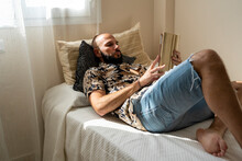 Modern Man Relaxing With His Tablet At Home