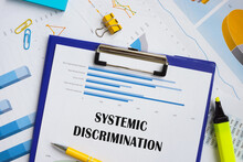 Business Concept Meaning Systemic Discrimination With Inscription On The Piece Of Paper.