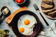 Fried Egg View Of Two Fried Eggs On A Frying Pan Ready To Eat With Breakfast Or Lunch