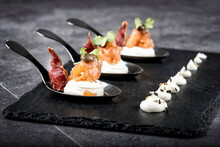 Smoked Salmon And Meat Slices Placed On Slate Board With Cream Cheese