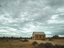 Old Church And Building In Outback Against A Dramatic Sky