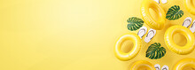 Summer Banner Yellow Background. Flip Flops, Leaf And Inflatable Swimming Ring Copy Space 3D Rendering