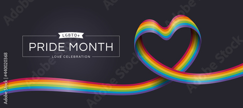 Fotografie, Obraz LGBTQ Pride month love celebration text and rainbow pride ribbon roll make heart