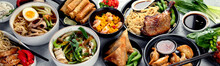 Assorted Asian Dishes And Snacks On Dark Gray Background. Traditional Food Concept.
