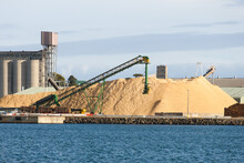Working Port And Machinery With Silos In Background