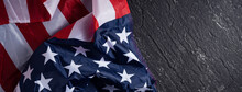 Concept Of Independence Day Or Memorial Day. Flag Over Dark Slate Table Background.