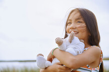 Cute Girl Looking Away While Holding Stuffed Teddy Bear