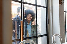 Man With Girlfriend Looking Inside Cafe Through Glass Window