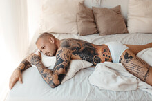 Handsome Young Man With Tattoos Boudoir In Barcelona Spain