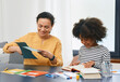 Professional child's psychologist working with an autistic girl child uses psychological session. Art psychotherapy session for autism