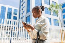 Female Entrepreneur Using Mobile Phone In City