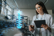 Female Engineer With Digital Tablet Examining Development Of Industrial Product