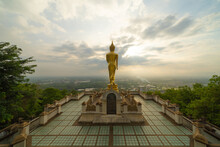 Aerial View Of Golden Buddha Pagoda Stupa. Wat Phrathat Khao Noi Temple Park, Nan, Thailand With Green Mountain Hills And Forest Trees. Thai Buddhist Temple Architecture. Tourist Attraction.