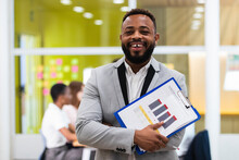 Young Businessman With Document Paper On Clipboard At Office