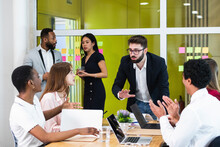 Male Entrepreneur Explaining Colleagues In Meeting At Workplace