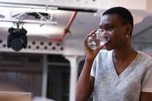 Female Entrepreneur Drinking Water In Office