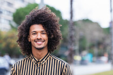 Young Man In Striped Shirt With Curly Hair