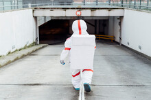 Female Astronaut Wearing Space Suit While Walking Down In Basement Parking
