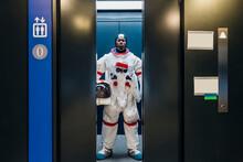 Male Astronaut Standing In Elevator