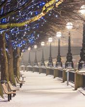 UK, England, London, Rows Of Street Lights Illuminating Empty South Bank Promenade In Winter