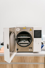 Autoclave Machine With Medical Supplies In It At Clinic