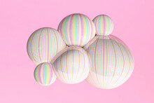 Yellow, Green And Pink Pastel Bubbles Against Pink Background