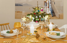 Festive Christmas Table With Small Christmas Tree In Background