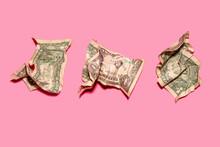 Studio Shot Of Three Crumpled One Dollar Bills