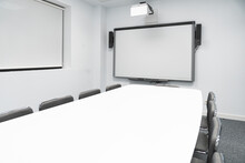 Empty Illuminated Board Room In Coworking Office