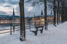 Germany, Hamburg, Illuminated City Architecture Reflecting In Binnenalster Lake At Dusk In Winter