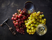 Studio Shot Of Fresh Grapes,corkscrewand Two Glass Of Red And White Wine