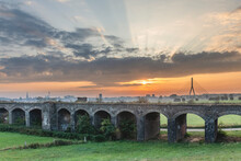 Germany, North Rhine-Westphalia, Wesel, Old Viaduct At Moody Sunrise