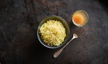 Studio Shot Of Bowl Of Basmati Rice. Single Fork And Glass Of Chai Tea