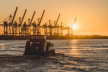 Germany, Hamburg, Harbor Ferry On Elbe River At Sunset