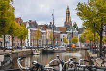 Netherlands, Groningen, City Canal With Row Of Townhouses In Background