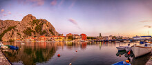 Croatia, Split-Dalmatia County, Omis, Panorama Of Coastal Town Situated At Confluence Of Adriatic Sea And Cetina River At Dusk