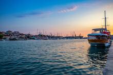 Croatia, Split-Dalmatia County, Trogir, Boats Moored Along Coast Of Ciovo Island At Dusk