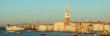 Italy, Veneto, Venice, Panorama Of Grand Canal At Dusk With Waterfront Houses And Saint Marks Campanile In Background