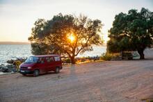 Sun Setting Over Van Parked Along Dirt Road In Amvrakikos Wetlands National Park