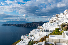 Greece, Santorini, Fira, Clouds Over White-washed Houses Of Town Situated At Edge Of Coastal Caldera