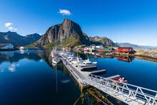 Fishing Boats By Pier At Reine, Lofoten, Norway
