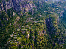 Norway, Rogaland, Lysebotn, Aerial View Of Cable Cars And Road Winding Along Steep Cliff