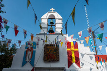 Greece, South Aegean, Horta, Various Flags Hanging In Front Of White-washed Church