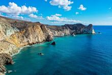 Greece, Santorini, Cliffs Along Blue Sea