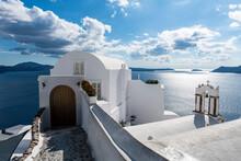 Greece, Santorini, Oia, Whitewashed Architecture Over Blue Sea