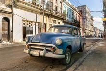 Vintage Blue Car Parking In The Street In Havanna