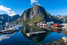 Boats Arranged By Mountain At Harbour Of Reine, Lofoten, Norway