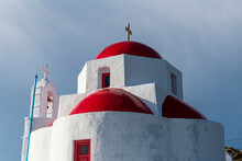 Architectural Domes Of Church With Religious Cross In Mykonos, Greece